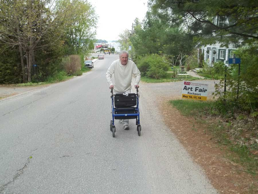 Climbing in Rockport on Gananoque tour with Bob Hardy and his blue Hugo Elite rollator walker