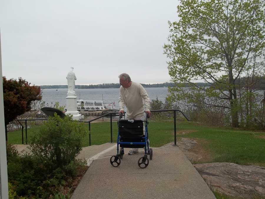Touring Gananoque with Bob Hardy and his blue Hugo Elite rollator walker